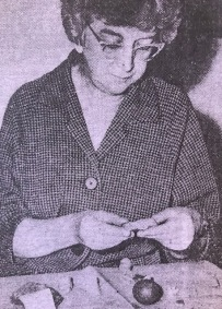 Phyllis Smith examining medieval pottery 1961